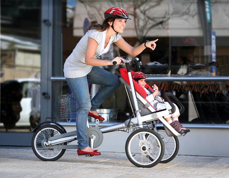 bicicleta con carrito de bebe taga