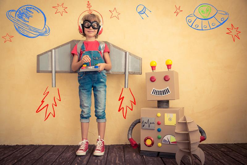 niño con robot